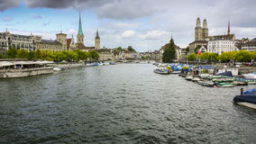 View from the Quaibrucke bridge looking along the Limmat river in Zurich, Switzerland. Fraumunster and Grossmunster churches Stock Photography