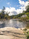 River View from a Rock with Rapids and Curvy Road. River view from a rock with rapids and curvy mountain road in background stock photography