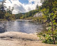 River View from a Rock with Rapids and Curvy Road. River view from a rock with rapids and curvy mountain road in background royalty free stock images