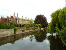 River view of the University of Cambridge. Bridges over river Cam with hanging willow and garden and colleges of the University of Cambridge Stock Image