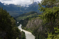 River view. A view up the river Inn, with rafting boat, kayak and an alpine backdrop Stock Photography