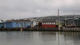 River view West Bay Dorset England uk with chalets and buildings stock video