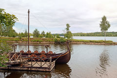 River with a viking boat at the pier Royalty Free Stock Images
