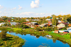 River and village Stock Images
