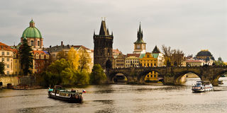 River Vltava and Charles Bride in Prague. River Vltava and Charles Bride in Prague with boats in autumn Royalty Free Stock Photography