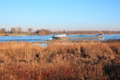 The river Waal in the Province Gelderland, the Netherlands, a panoramic view. In autumn royalty free stock photo