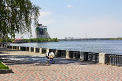 The river walk and children to. Embankment of the Dnipro river, in the center of the frame stroller, walk with a small child Stock Photo
