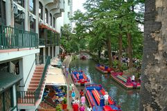 River Walk with Colorful Boats. View of San Antonio River Walk with tourists and colorful boats Royalty Free Stock Image