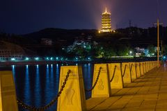 River walk in Longquan, Zhejiang, China. Scenic night time shot of the river walk in Longquan, Zhejiang, China. The historic Pagoda can be seen in the background royalty free stock photos