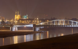 River Warta, bridge and cathedral at night Stock Images