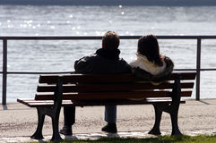 River Watching. Couple by River Main in Frankfurt during winter Royalty Free Stock Photos