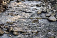 River water flowing over rocks in winter. royalty free stock photo