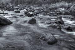 River water flowing through rocks at dawn Stock Photo