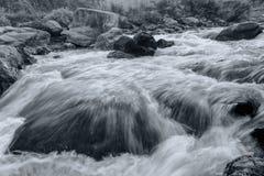 River water flowing through rocks at dawn Royalty Free Stock Photos