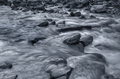 River water flowing through rocks at dawn Royalty Free Stock Images