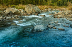 River water flowing through rocks at dawn Stock Photography