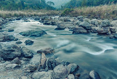River water flowing through rocks at dawn, Sikkim, India Royalty Free Stock Photo