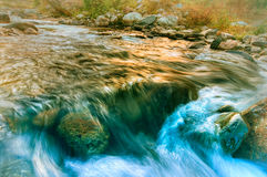 River water flowing through rocks at dawn, Sikkim, India Stock Photo