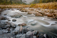 River water flowing through rocks at dawn, Sikkim, India Stock Images