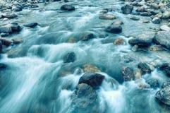 River water flowing through rocks at dawn, Sikkim, India Royalty Free Stock Photos