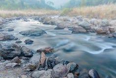 River water flowing through rocks at dawn, Sikkim, India Stock Photos