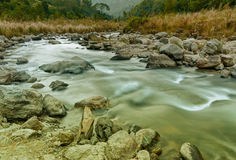 River water flowing through rocks at dawn, Sikkim, India Stock Photos