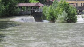 River water move down from a barrier to a lower level. Weirs are building to reduce erosion during storm events