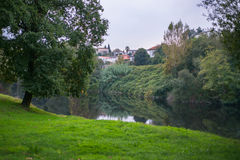 River water reflection green grass meadow tree village town Royalty Free Stock Photography