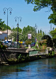 River and Water Wheel in L'Isle sur la Sorgue Royalty Free Stock Photo