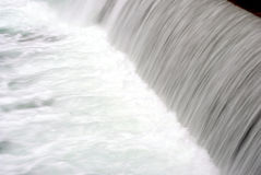 River with waterfall. And rapid and violent white foam and clean royalty free stock photo