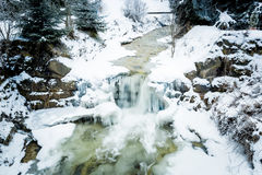 River with waterfall in Austrian Alps at snowy day Stock Photography