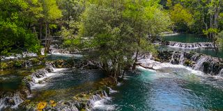 A river and waterfall in Bosnia stock image