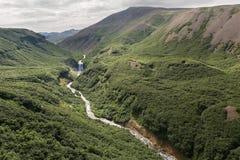 River and waterfall in the Caldera volcano Ksudach. South Kamchatka Nature Park. Royalty Free Stock Image