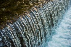 Waterfall closeup in river in kyoto royalty free stock images