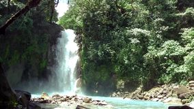 A river with waterfall in Costa Rica. Rio Celeste - A river with waterfall in Costa Rica stock video footage