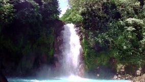 A river with waterfall in Costa Rica. Rio Celeste - A river with waterfall in Costa Rica stock video