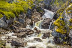 River Waterfall with long exposure and blurred water flow Stock Image