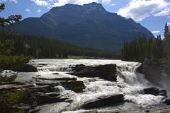River waterfall in the Rocky Mountains Stock Images