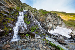 River watterfall flowing over rough rocks Stock Image