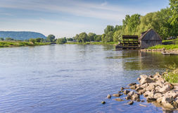 River Weser and old wooden mill near Minden Stock Photo