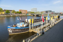 River Weser with ship MS Treue anchored at river bank Stock Images
