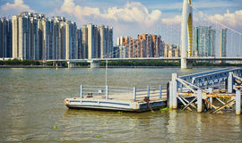 Wharf quay in city river. Wharf, quay, dock in Zhujiang River. Asian Chinese modern city view, cityscape, urban scenery and city skyline in Guangzhou City royalty free stock photography