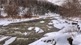 River Beside White Snow during Daytime Stock Images