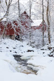 River in winter and barns Stock Images