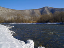 The river in the winter at a mountain slope Stock Image