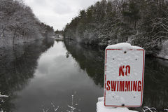 River in Winter with No Swimming Sign Stock Photos