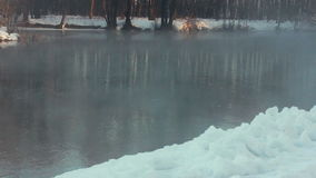 River in winter park. Winter landscape. Snow drifts on river bank. Cold weather stock footage