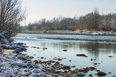 River in Winter. Rapids of Stormy River. Winter Landscape. Stock Photo