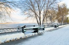 The river in winter the snow around the fence. Benches and table all covered with snow Stock Image