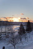 The river in the winter at sunset in Russia stock photo